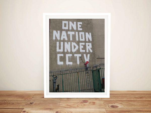 Buy a Framed Banksy One Nation Canvas Print