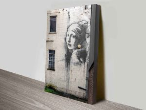 Lady On The Wall Art Print by Banksy