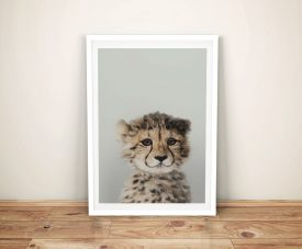 Buy a Cute Cheetah Cub Peekaboos Framed Print